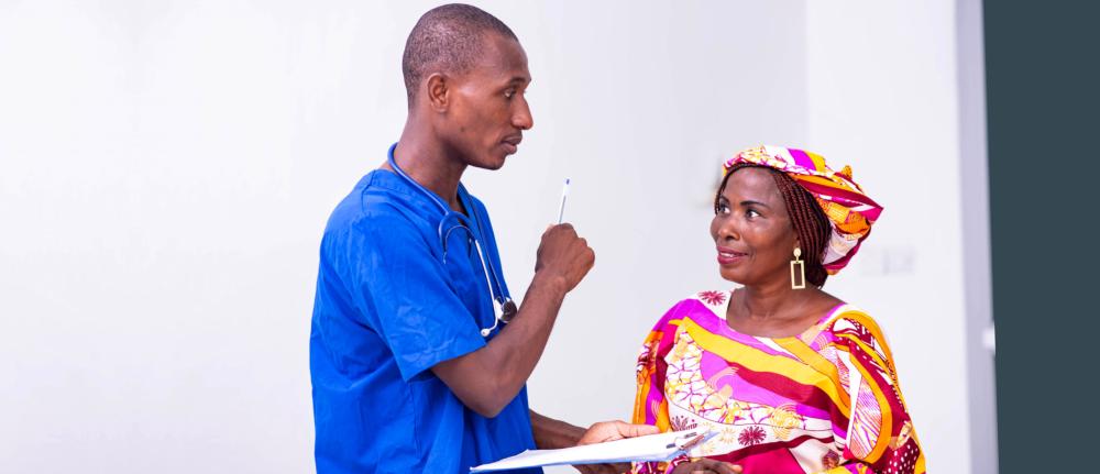 male nurse and senior man smiling