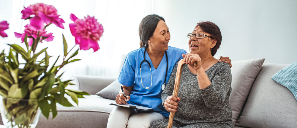 Caregiver and senior women facing each other